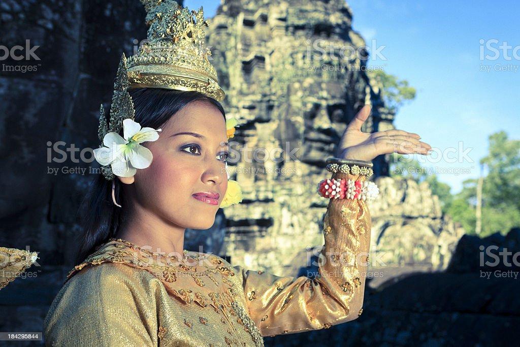 Golden apsara dancer at Bayon temple royalty-free stock photo