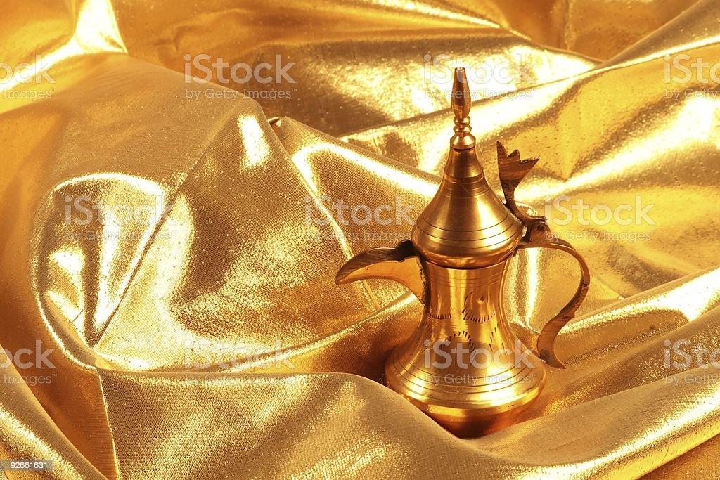 Golden arabic coffee / tea pot royalty-free stock photo
