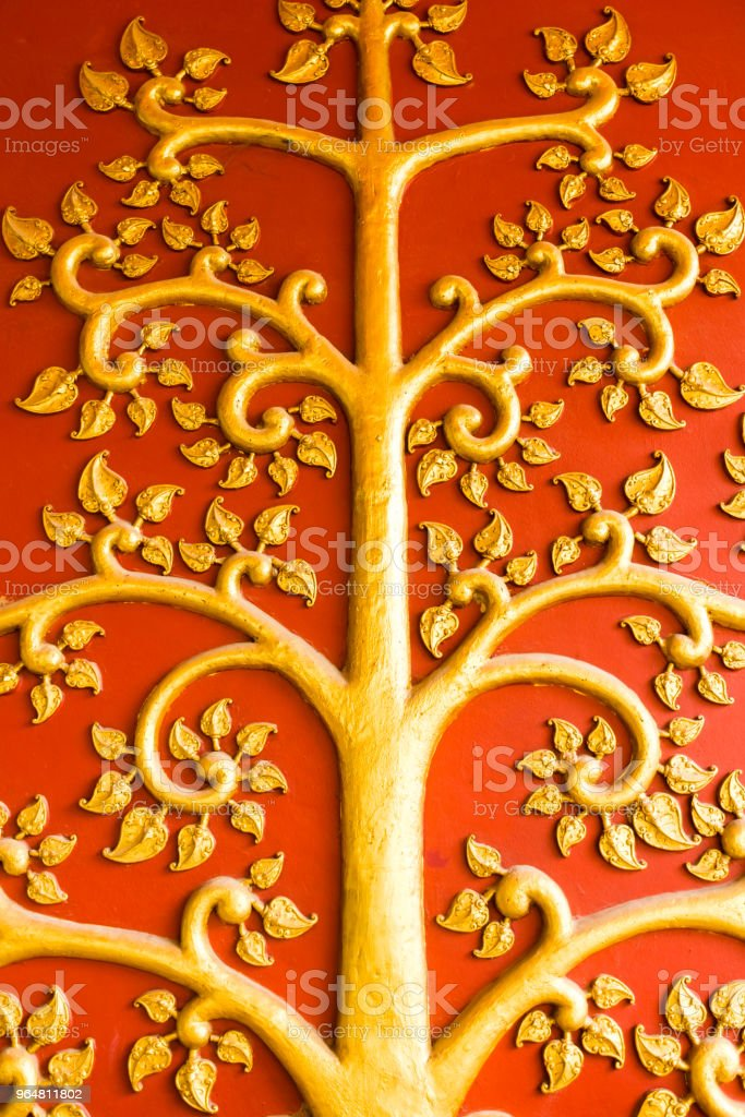 Golden artistic wall, Wat Khunaram Temple, Koh Samui, Thailand royalty-free stock photo