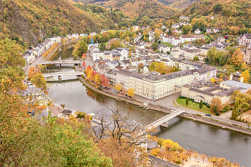 Golden autumn in the resort town of Bad Ems, Germany. View of the Lan River, bridges, city and hills. Autumn colors.