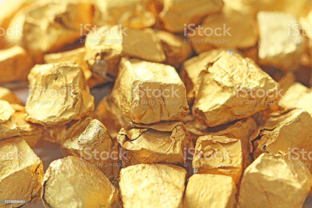 Golden Background. Ingots or Nuggets of Pure Gold. Gold leaf. Tea...