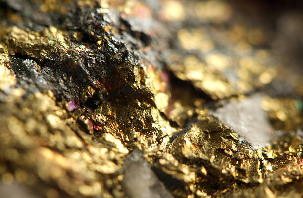 golden background. macro - gold mine stock photos and pictures