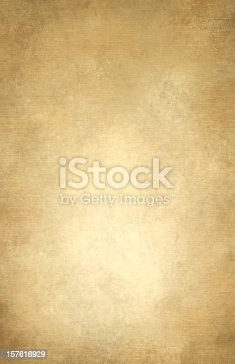 Mottled gold and tan muslin type background with grid spot.