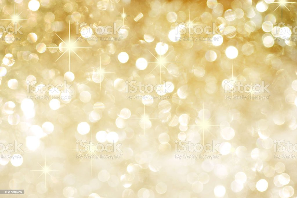 Golden background with stars stock photo