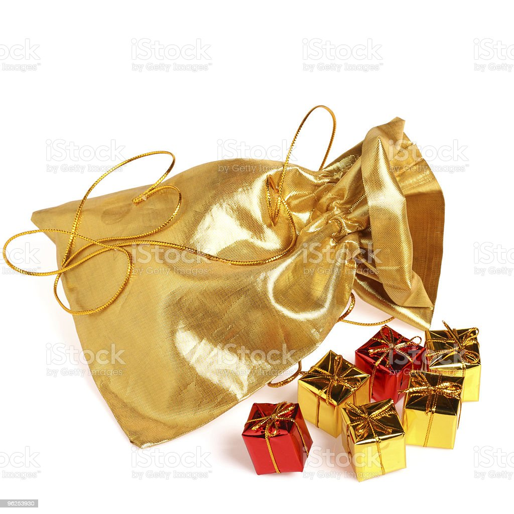 Golden bag with gift boxes royalty-free stock photo