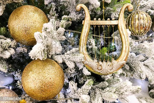 christmas decoration on the tree. christmas composition. golden balls on the christmas tree. christmas background