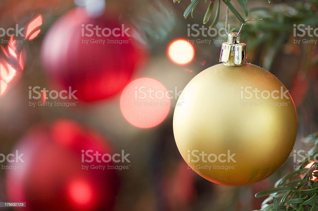 Golden Bauble in Christmas Tree royalty-free stock photo