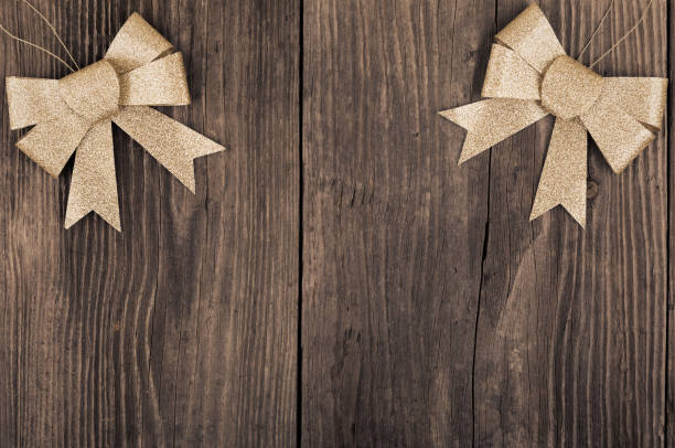 Golden baubles on wooden background stock photo