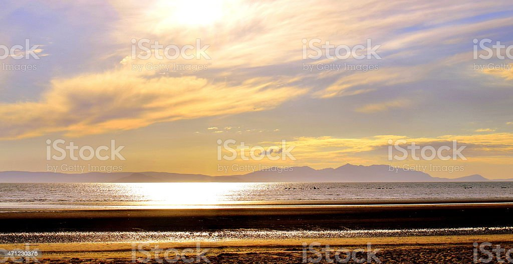 Golden Beach and distant isle stock photo