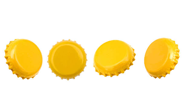 Golden beer caps Golden beer caps isolated white bottle cap stock pictures, royalty-free photos & images