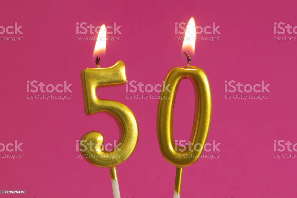 Golden Birthday Candles On Pink Number 50 Stock Photo