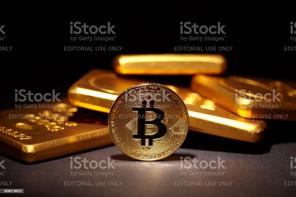 Golden Bitcoin Coin and Gold Bars stock photo