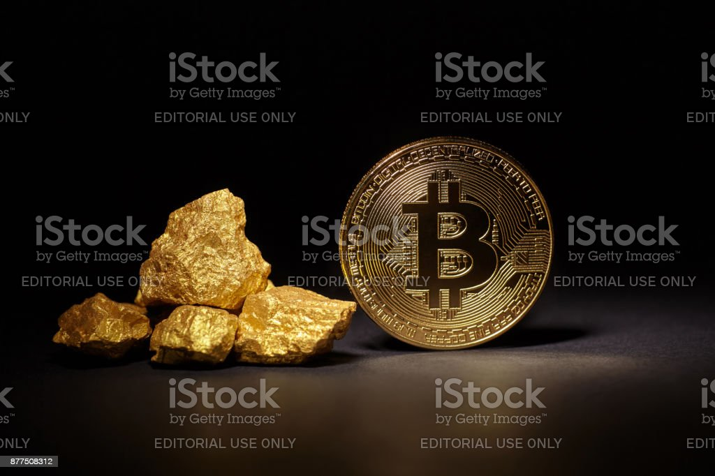 Golden Bitcoin Coin and mound of gold on black background stock photo