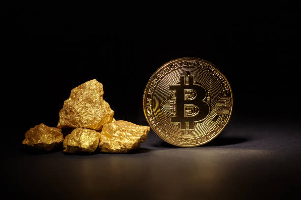 """Golden Bitcoin Coin and mound of gold on black background Kiev, Ukraine - September 19, 2017: Studio shot of Golden Bitcoin Coin and mound of gold on black background. The Bitcoin was invented by Satoshi Nakamoto in 2008 as a digital form of money""""nThis is a close up photo of several gold plated bitcoins together symbolizing the bit coin market, modern technology, finance, internet, trading, etc. """"nBitcoin introduced in 2009 cross-national payment system in the form of virtual money, to be used in the cryptographic techniques (cryptocurrency). bitcoin and gold stock pictures, royalty-free photos & images"""
