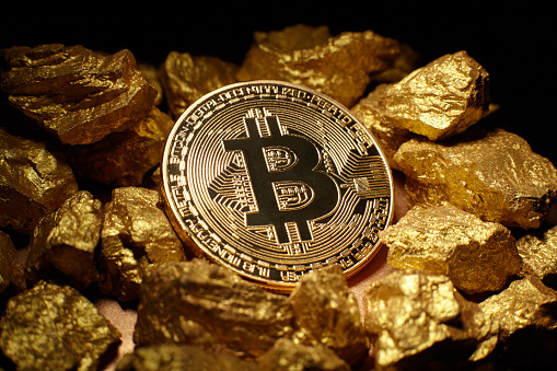 Golden Bitcoin Coin And Mound Of Gold Stock Photo - Download Image Now