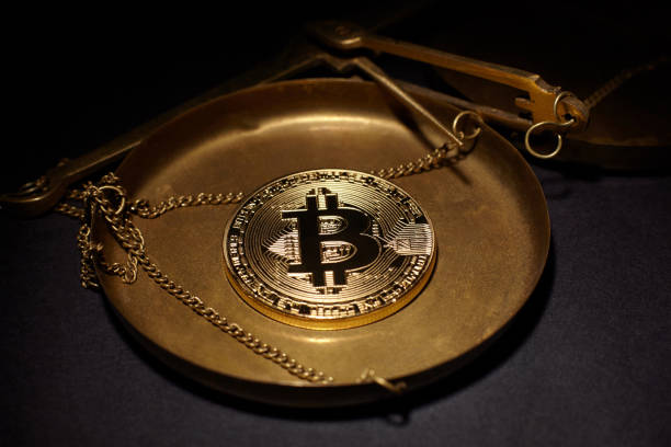 Golden Bitcoin Coin and scales copper stock photo