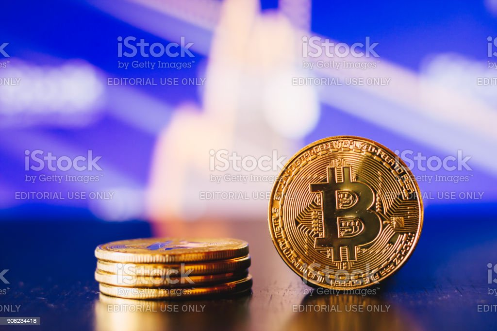 Golden Bitcoin Coin On Blue Background Stock Photo