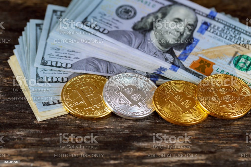 Golden bitcoin coins on a paper dollars money Virtual currency. stock photo