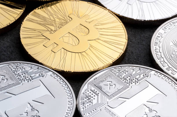 Golden Bitcoins and Litecoin popular Cryptocurrency payment system stock photo