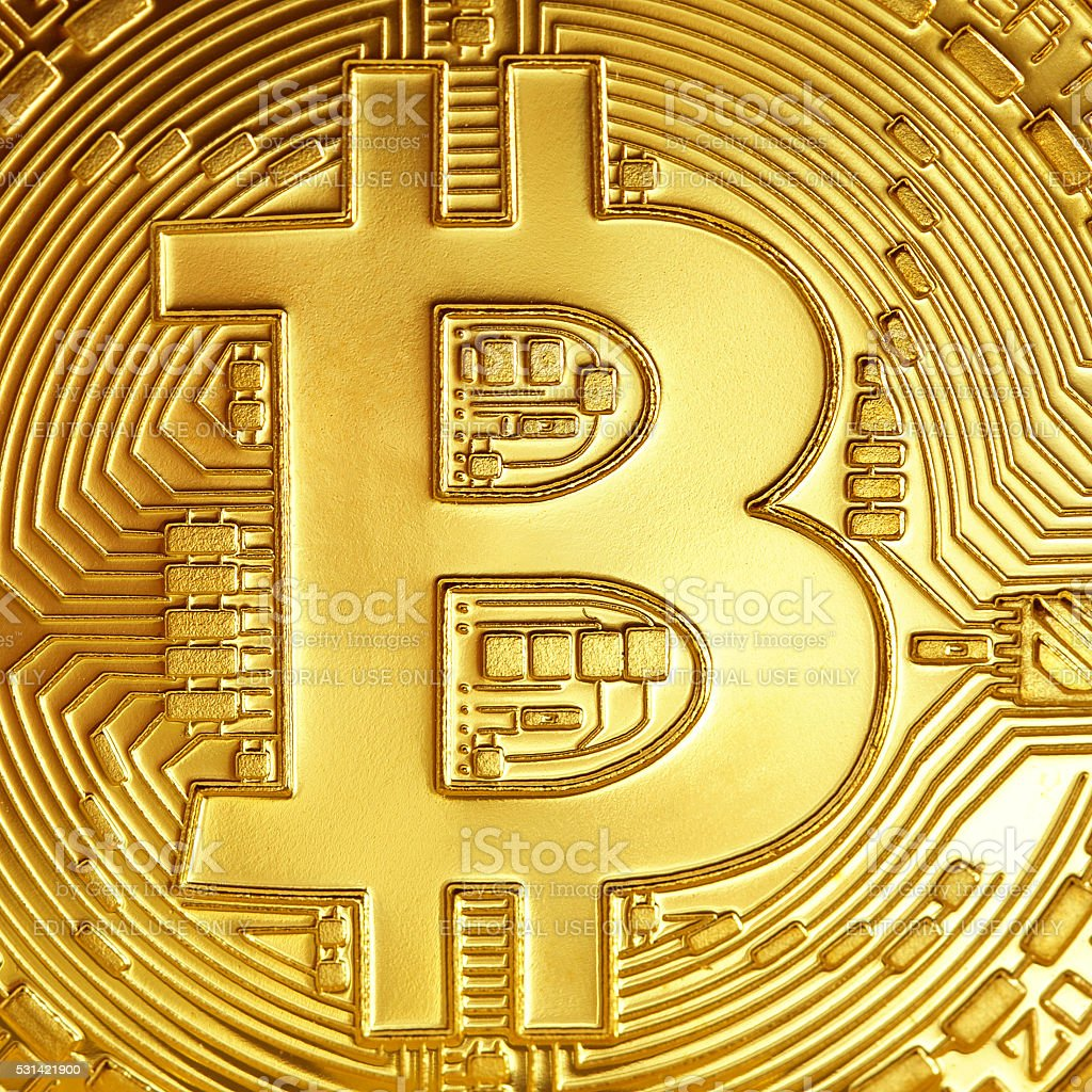 Golden Bitcoins close-up . stock photo
