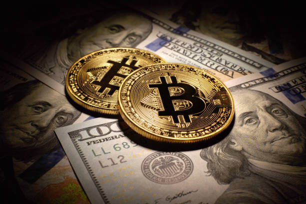Golden Bitcoins Coins and dollar bills stock photo