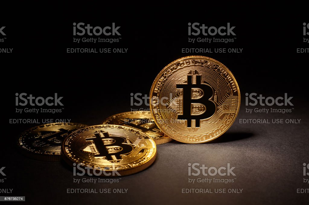 Golden Bitcoins Coins on black background stock photo
