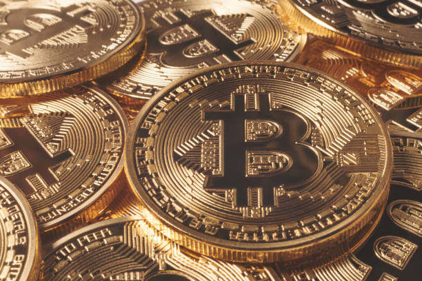 Golden Bitcoins. New virtual money. stock photo