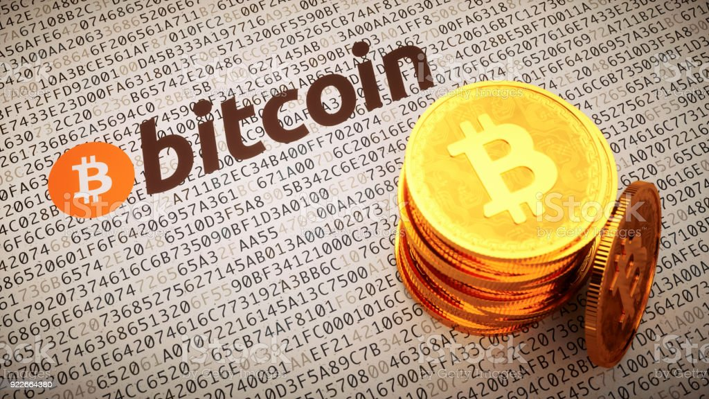 Golden Bitcoins with logo an label stock photo