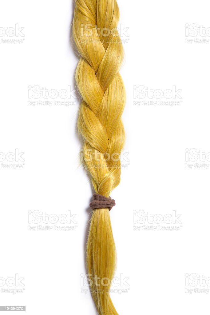 Golden blond hair braided in pigtail stock photo