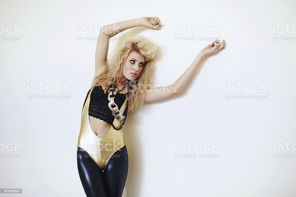 Golden Blonde in Unitard Holding Arms Up royalty-free stock photo