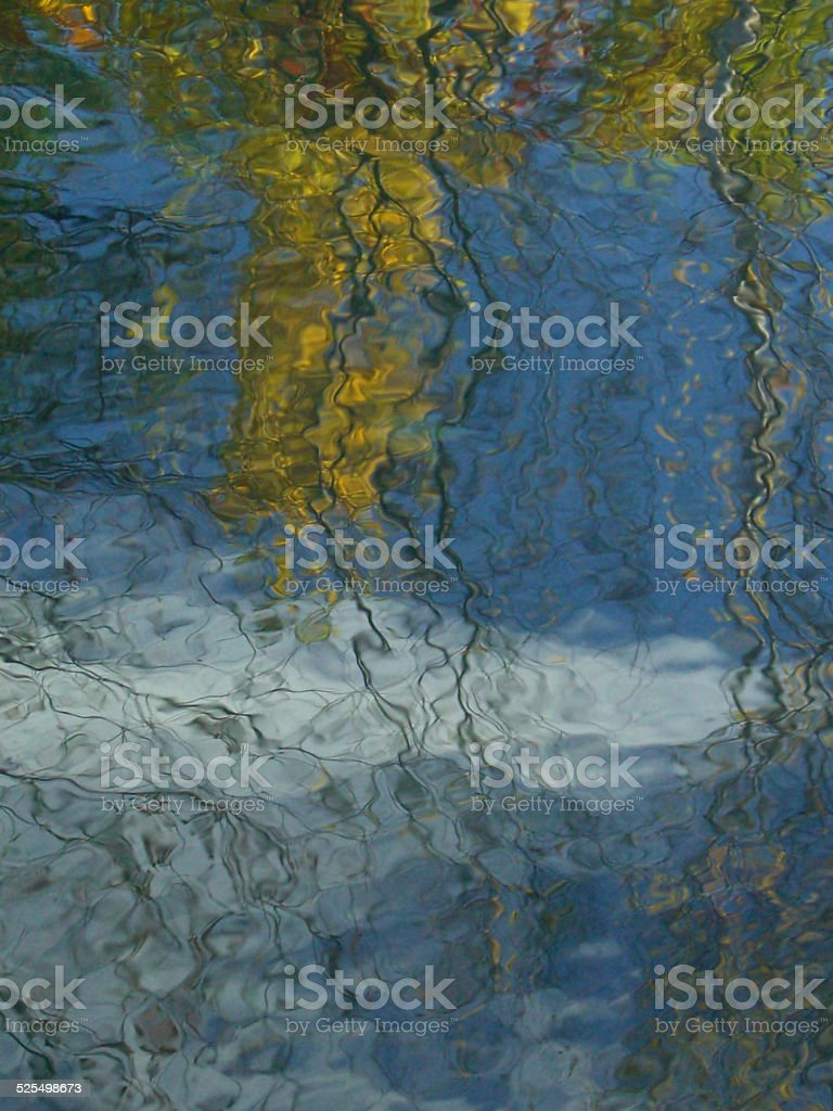 Golden Blue and White Water Reflections stock photo