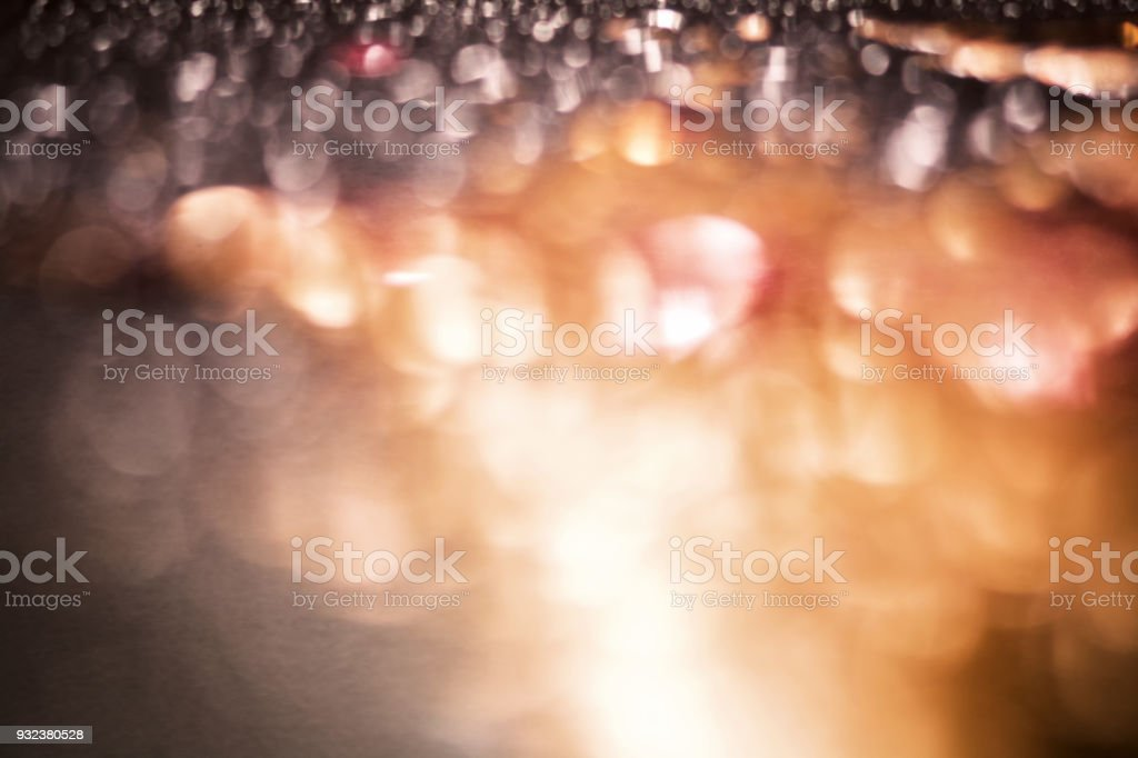 Golden blur bokeh background. Beautiful sparkling background in brown shades. stock photo