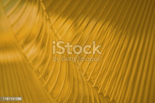 512401542istockphoto Golden blurry background. Gold background. Gold texture 1161141288