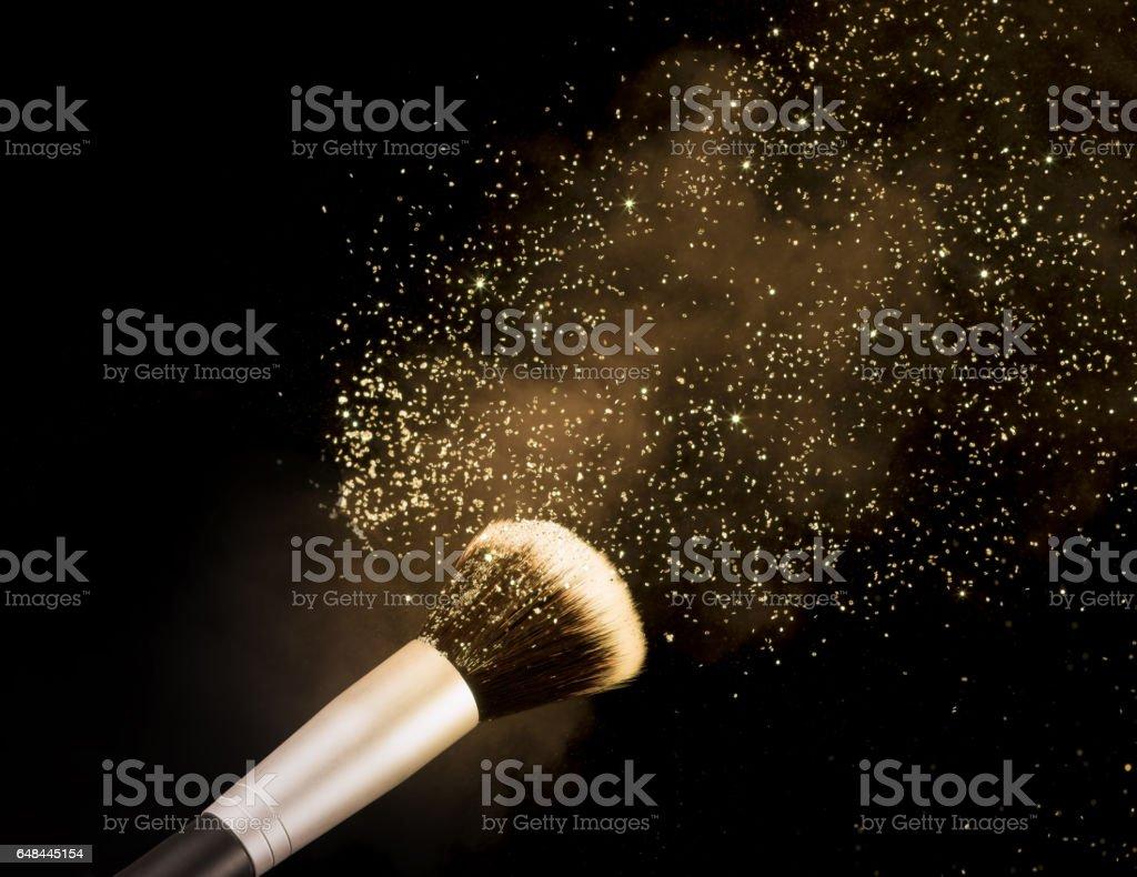 golden blusher explosion isolated on black background stock photo