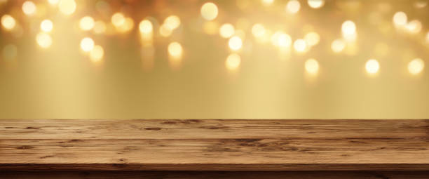 Golden bokeh background with rustic table stock photo