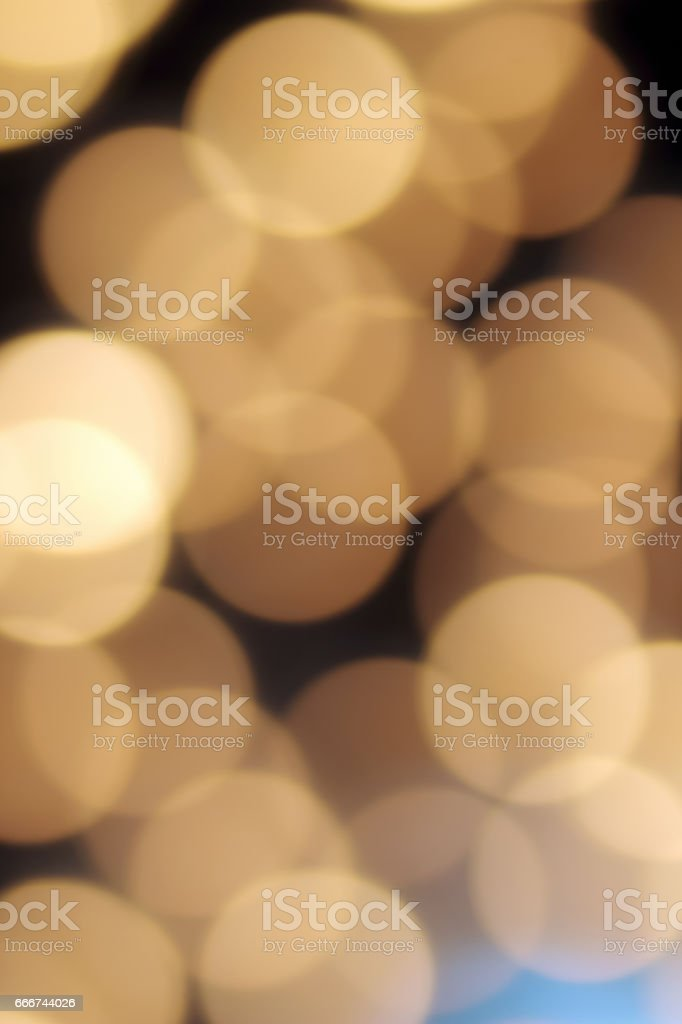 golden bokeh on a black background, abstract dark backdrop with defocused warm lights and blue highlight foto stock royalty-free