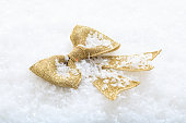 istock Golden bow on snow 1031620014