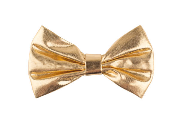 golden bow tie on white background golden shinny bow tie isolated on white background bow tie stock pictures, royalty-free photos & images