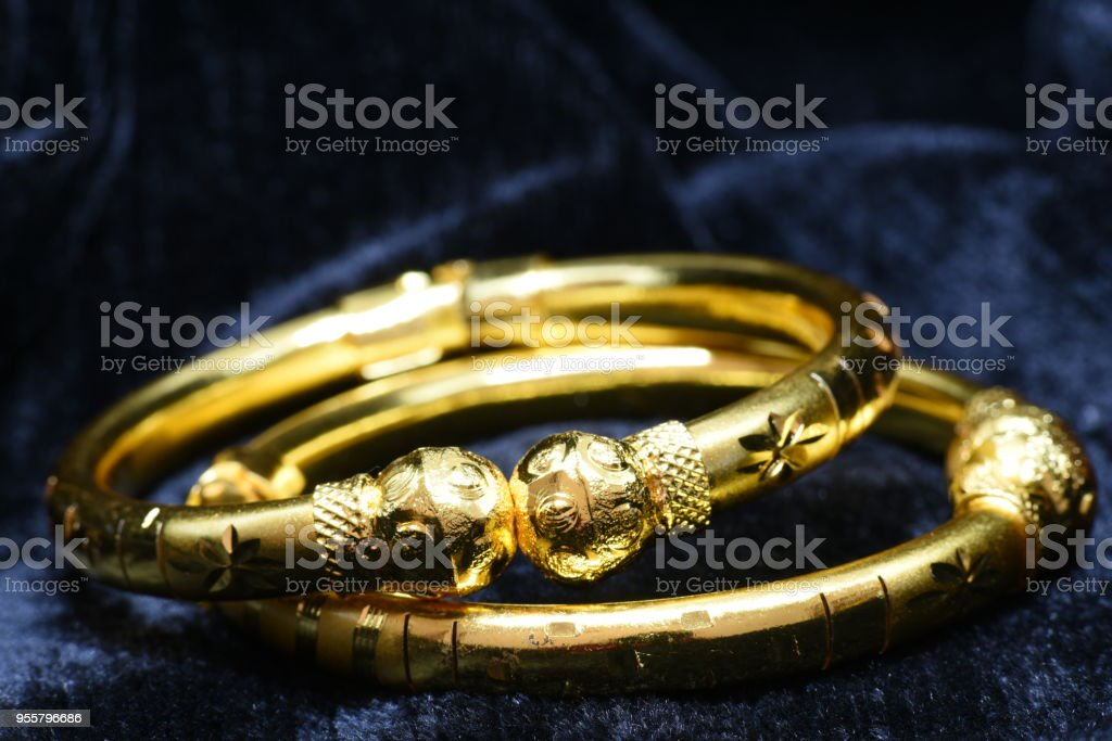 Golden bracelet closeup macro image on black background stock photo