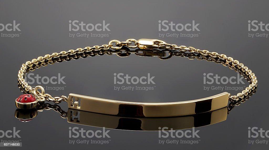 golden bracelet isolated on black stock photo