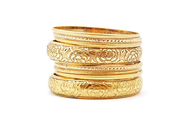 golden bracelets golden bracelets on white background wristband stock pictures, royalty-free photos & images