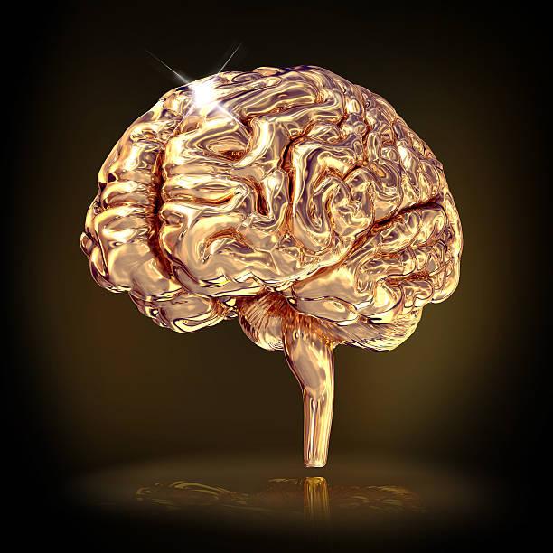 Golden Gehirn auf schwarzem Hintergrund. – Foto