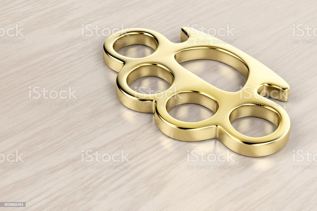 Golden brass knuckles stock photo