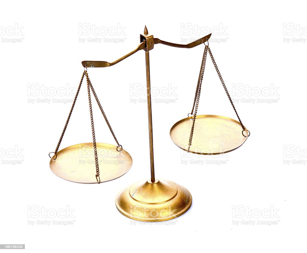 golden brass scales of justice on white stock photo