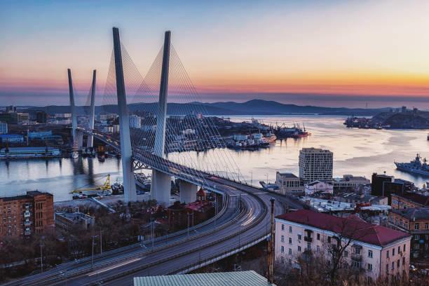 Golden bridge and Golden Horn bay at sunset, Vladivostok, Russia stock photo