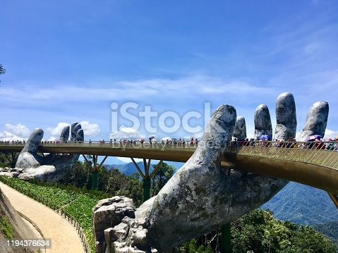 The Golden Bridge is lifted by two giant hands on Ba Na Hills mountain resort in Danang, Vietnam