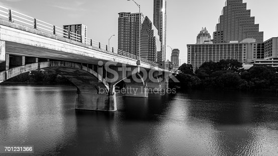 istock Golden Bridge Sunrise over Lady Bird Lake Deep Perspective Austin Texas USA black and white 701231366