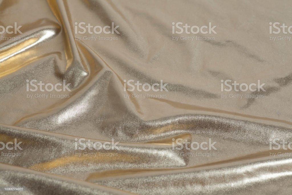 Ondas de tecido brocado dourado - foto de acervo