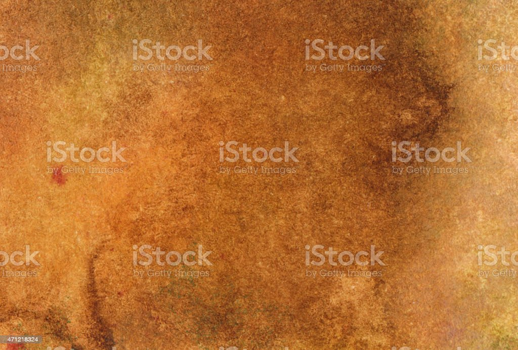 Golden brown antiqued background on paper stock photo