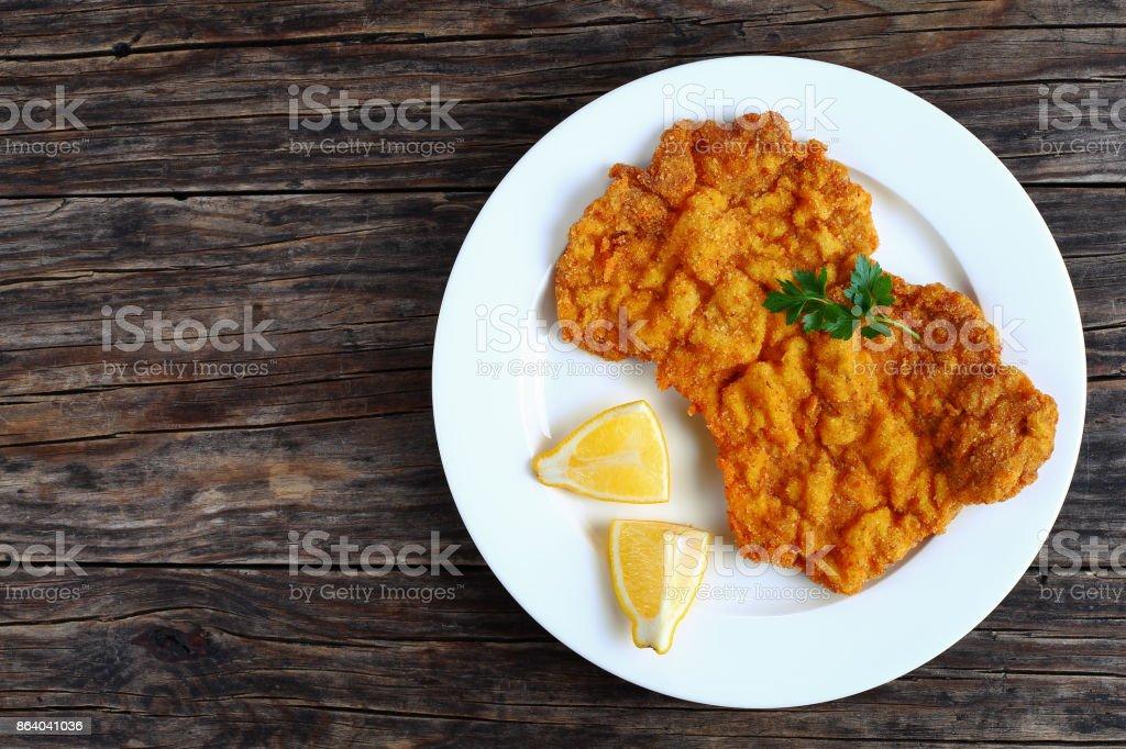 golden brown classic Wiener schnitzel on plate stock photo